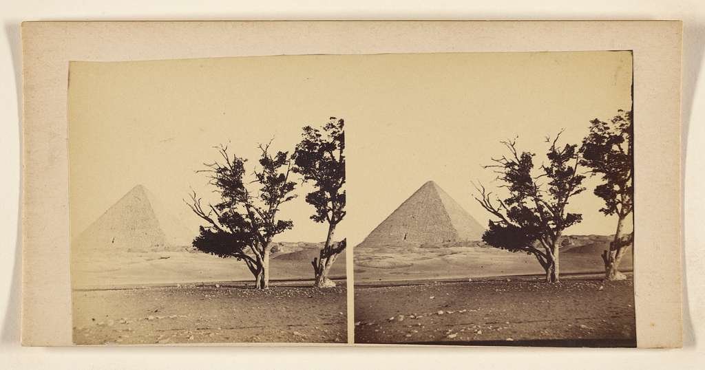 [View of a pyramids with trees at right foreground]