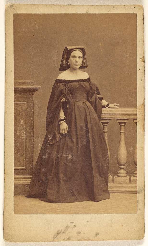 [Unidentified female opera singer wearing a hat, standing]