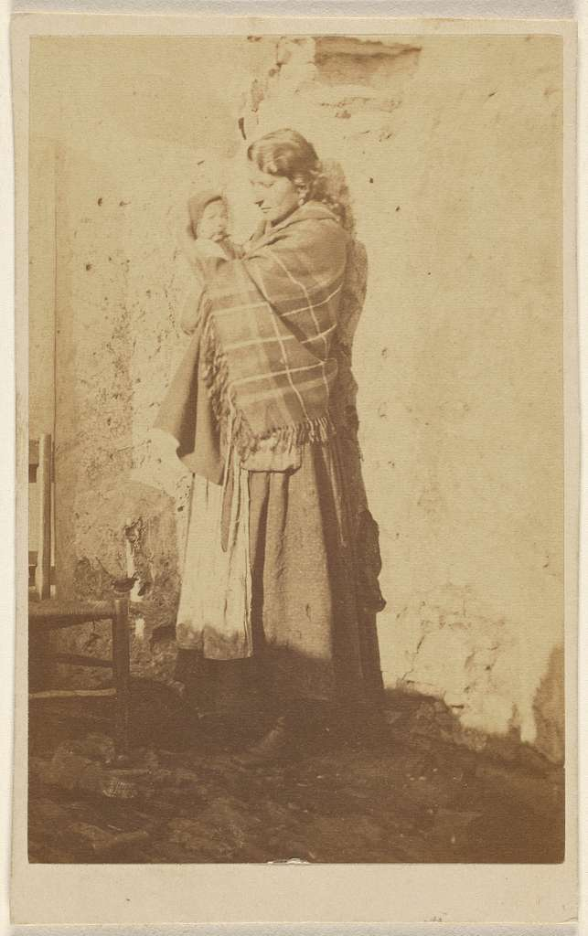 [Unidentified woman wearing a shawl, holding a baby]