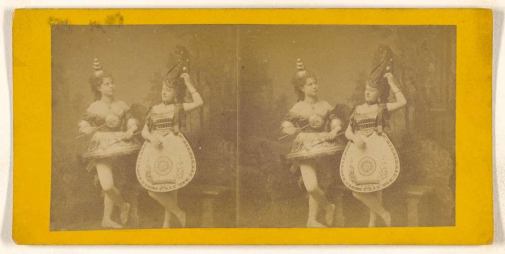 "[Women dressed in ""instrument"" costumes]"