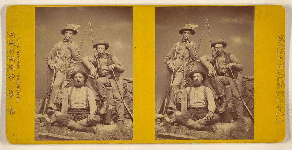 [Posed portrait of three farmers]