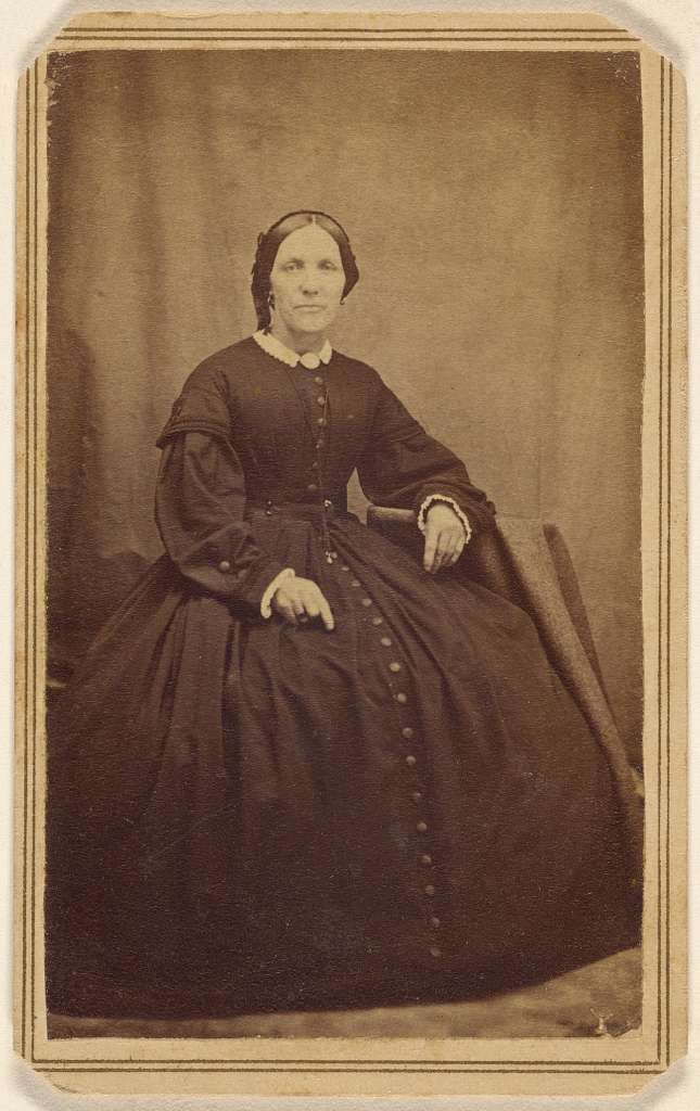 [Unidentified woman, seated]